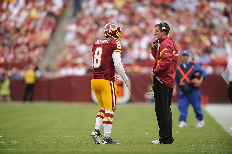 Redskins' quarterback Rex Grossman talks with offensive coordinator Kyle Shanahan during the third quarter against the Arizona Cardinals at FedEx Field in Landover, Md., on Sunday, September 18, 2011. (Andrew Harnik/The Washington Times)