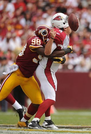 Washington Redskins linebacker Brian Orakpo (98) sacks Arizona Cardinals quarterback Kevin Kolb forcing a fumble that was recovered by the Cardinals in the second quarter at FedEx Field in Landover, Md., on Sunday, Sept. 18, 2011. (Andrew Harnik/The Washington Times)