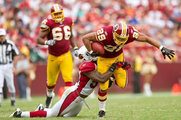 Washington Redskins RB Roy Helu (29) is tackled by Arizona Cardinals LB O'Brien Schofield (50) on a 9-yard run in the fourth quarter at FedEx Field in Landover, Md., on Sunday, Sept. 18, 2011. (Andrew Harnik/The Washington Times)