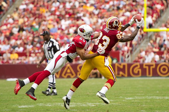 Washington Redskins TE Fred Davis (83) makes a 3-yard catch before being tackled by FS Kerry Rhodes (25) for the Arizona Cardinals at FedEx Field in Landover, Md., on Sunday, Sept. 18, 2011. (Andrew Harnik/The Washington Times)