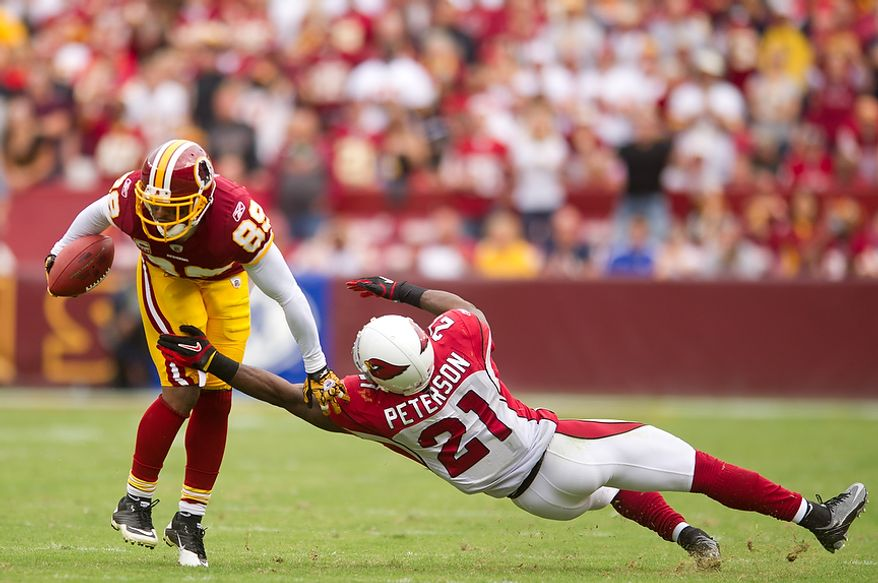 Washington Redskins WR Santana Moss (89) is tackled by Arizona Cardinals CB Patrick Peterson (21) after a 12-yard gain the the fourth quarter at FedEx Field in Landover, Md., on Sunday, Sept. 18, 2011. (Andrew Harnik/The Washington Times)