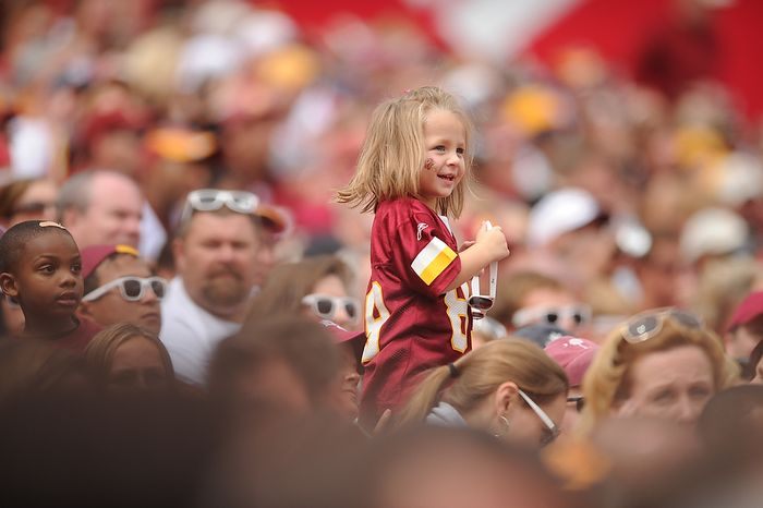 A young Washington Redskins fan watches the game against the Arizona Cardinals at FedEx Field in Landover, Md., on Sunday, Sept. 18, 2011. (Andrew Harnik/The Washington Times)