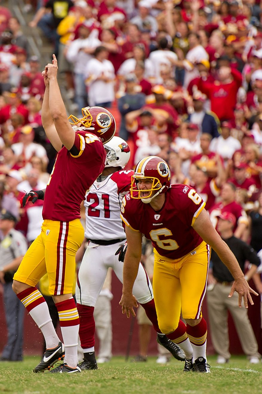 Washington Redskins kicker Graham Gano (4) and punter Sav Rocca (6) celebrate a 34-yard field goal in the fourth quarter to put the Redskins up by 1 against the Arizona Cardinals at FedEx Field in Landover, Md., on Sunday, Sept. 18, 2011. (Andrew Harnik/The Washington Times)