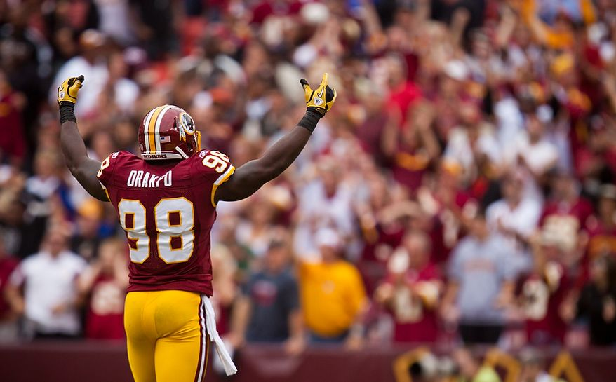 Washington Redskins linebacker Brian Orakpo (98) pumps up the crowd after the Redskins recovered a fumble during the fourth quarter of the game with the Arizona Cardinals at FedEx Field in Landover, Md., on Sunday, Sept. 18, 2011. (Pratik Shah/The Washington Times)