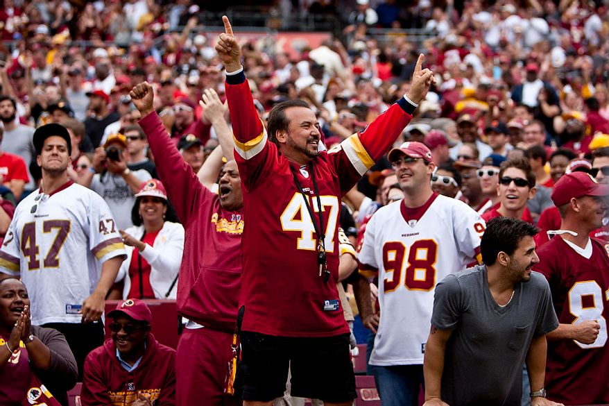 Redskins fans celebrate as the clock runs out in the fourth quarter as the Washington Redskins beat the Arizona Cardinals 22-21 at FedEx Field in Landover, Md., on Sunday, Sept. 18, 2011. (T.J. Kirkpatrick/The Washington Times)