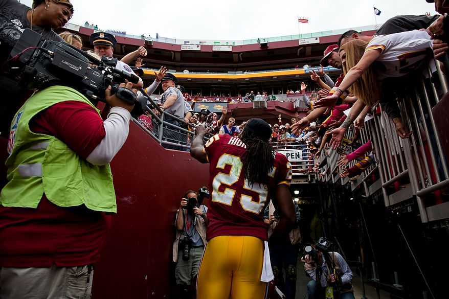 Washington Redskins running back Tim Hightower (25) waves to the crowd as he exits the field after the Redskins defeated the Arizona Cardinals at FedEx Field in Landover, Md., on Sunday, Sept. 18, 2011. (Pratik Shah/The Washington Times)