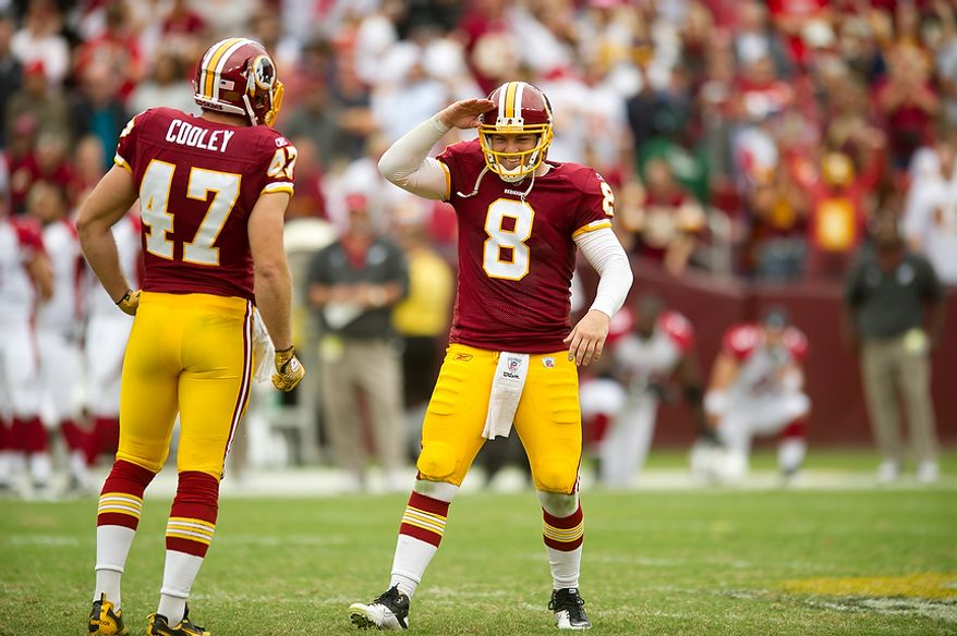 Washington Redskins QB Rex Grossman (8) salutes after referees review an incomplete pass and rule that it was instead a fumble, giving the Redskins the ball with a minute and a half left in the fourth quarter against the Arizona Cardinals at FedEx Field in Landover, Md., on Sunday, Sept. 18, 2011. (Andrew Harnik/The Washington Times)