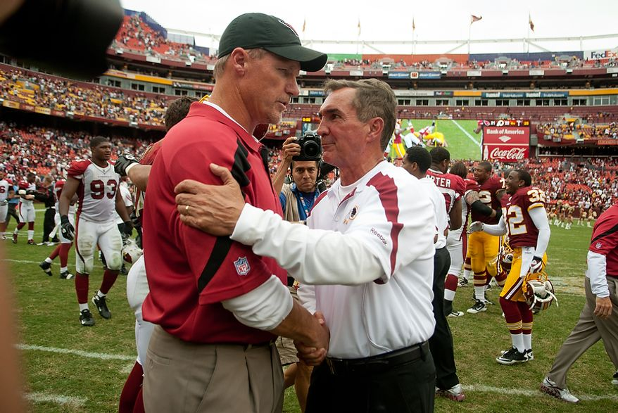 Washington Redskins head coach Mike Shanahan shakes hands with Arizona Cardinals Ken Whisenhunt after the Redskins win 22-21 at FedEx Field in Landover, Md. Sunday, September 18, 2011. (Andrew Harnik / The Washington Times)