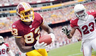 Redskins tight end Fred Davis, shown snaring a 1-yard touchdown pass Sunday, has 191 receiving yards the first two games. (Andrew Harnik/The Washington Times)