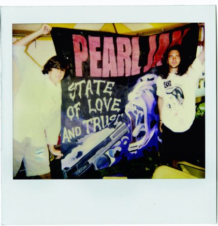 Vinyl Films photographs Director Cameron Crowe (left) and Eddie Vedder unfurl a Pearl Jam flag in Italy in 1993.