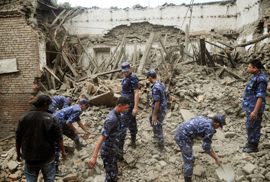 Police on Monday, Sept. 19, 2011, look for victims in a house that collapsed after Sunday's earthquake in Bhaktapur, Nepal, about 9 miles from Katmandu, the capital.  (AP Photo)