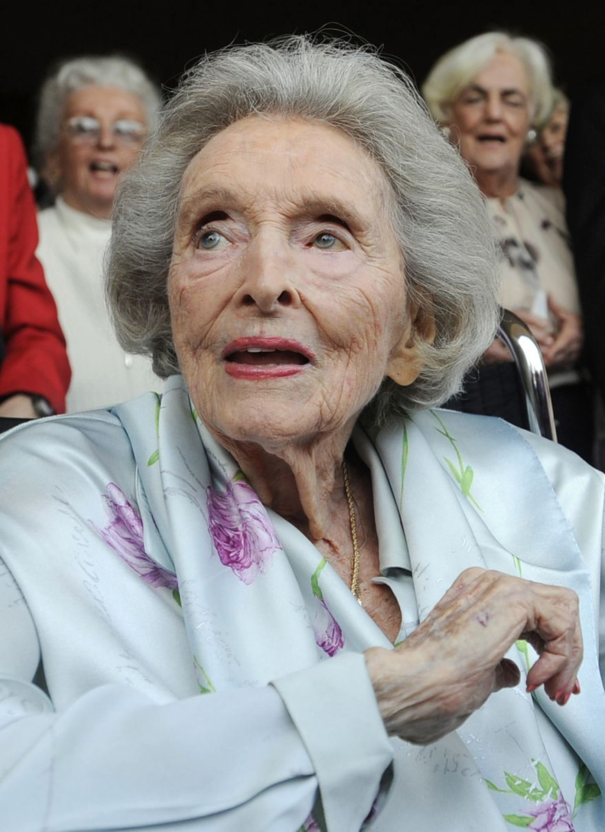 "ILE - In this May 27, 2009 file photo, Dolores Hope, the widow of legendary comedian Bob Hope, looks on as partygoers sing ""Happy Birthday"" to her during her 100th birthday party in Los Angeles. Hope, who was married to Bob Hope for 69 years and sang at his shows, died Monday, Sept. 19, 2011 of natural causes at home in Los Angeles. She was 102. (AP Photo/Chris Pizzello, file)"