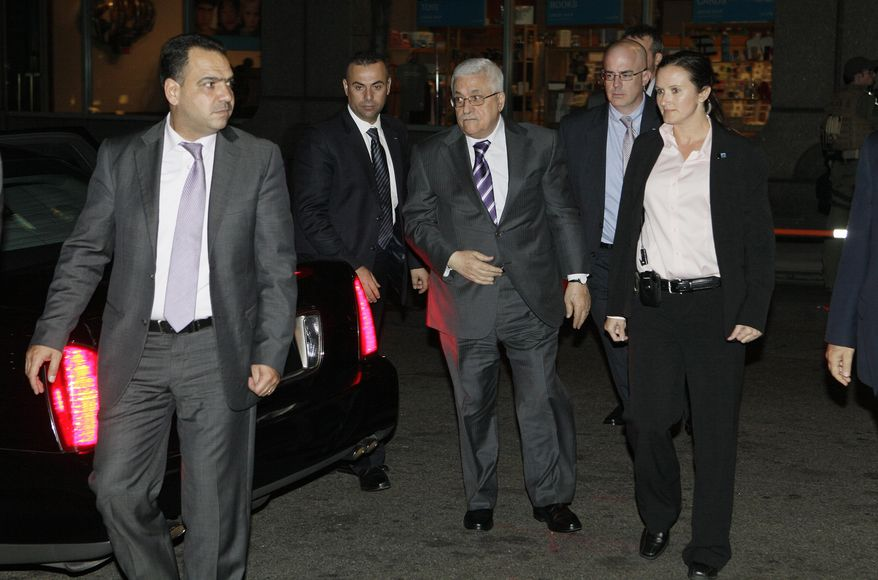Palestinian President Mahmoud Abbas (center) arrives at his hotel in New York on Monday, Sept. 19, 2011, to attend the 66th General Assembly session of the United Nations. (AP Photo/David Karp)