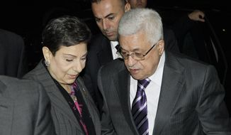 Palestinian President Mahmoud Abbas (right) is greeted by legislator and activist Hanan Ashrawi (left) as he arrives at his hotel in New York on Sept. 19, 2011, to attend the 66th General Assembly session of United Nations, which begins Sept. 20. (Associated Press)