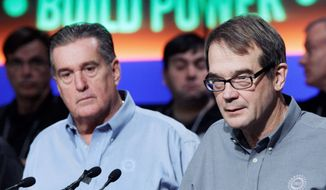 """The auto industry is back. General Motors and the UAW are working together to create jobs in America,"" United Auto Workers President Bob King (right, with union Vice President Joe Ashton) said Tuesday in Detroit. (Associated Press)"