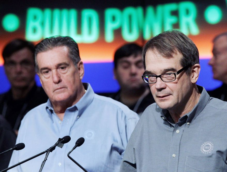 """""""The auto industry is back. General Motors and the UAW are working together to create jobs in America,"""" United Auto Workers President Bob King (right, with union Vice President Joe Ashton) said Tuesday in Detroit. (Associated Press)"""