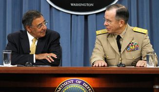 "Defense Secretary Leon E. Panetta and Joint Chiefs of Staff Chairman Adm. Mike Mullen confer while briefing the news media Tuesday on the end of the ""don't ask, don't tell"" policy. Mr. Panetta said repealing the ban on openly gay military service was a ""historic day."" (Associated Press)"