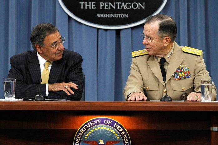"""Defense Secretary Leon E. Panetta and Joint Chiefs of Staff Chairman Adm. Mike Mullen confer while briefing the news media Tuesday on the end of the """"don't ask, don't tell"""" policy. Mr. Panetta said repealing the ban on openly gay military service was a """"historic day."""" (Associated Press)"""
