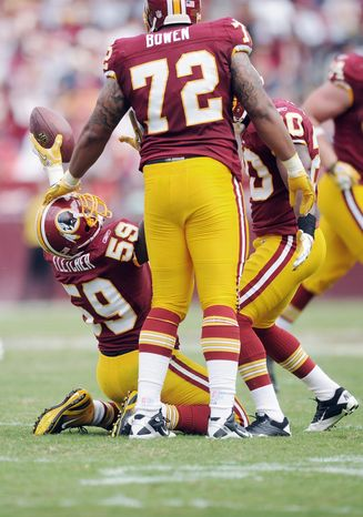 Andrew Harnik/The Washington Times London Fletcher, here celebrating a third-quarter interception Sunday, is a 14-year veteran who has been with the Redskins since 2007.