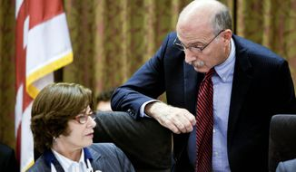 A TAXING MOVE: D.C. Council member Mary M. Cheh confers with fellow council member Phil Mendelson on Tuesday. Mr. Mendelson led the charge in a push to increase the city's income-tax rate on high-income earners. (T.J. Kirkpatrick/The Washington Times)