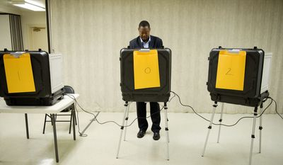 Candidate Derrick Leon Davis votes at the Kettering Baptist Church voting precinct in Upper Marlboro on Tuesday during the 6th District special election in Prince George's County to fill Leslie E. Johnson's County Council seat. (Rod Lamkey Jr./The Washington Times)
