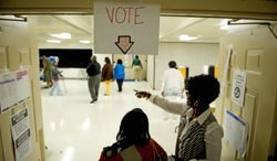 Election judge Yvonne Barnes directs a voter to the check-in table at the Kettering Baptist Church precinct during Prince George's County special election on Tuesday. Winners of the Democratic and Republican primaries will face off in October. (Rod Lamkey Jr./The Washington Times)