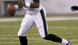 Philadelphia Eagles' quarterback Vince Young rolls out during the first quarter of an NFL preseason game between Philadelphia and the New York Jets, Sept. 1, 2011, in East Rutherford, N.J. (AP Photo/Seth Wenig)
