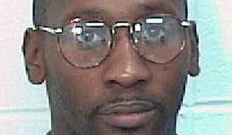 **FILE** This photo provided by the Georgia Department of Corrections shows death row inmate Troy Davis, who was convicted of killing an off-duty Savannah police officer in 1989. (Associated Press/Georgia Department of Corrections)