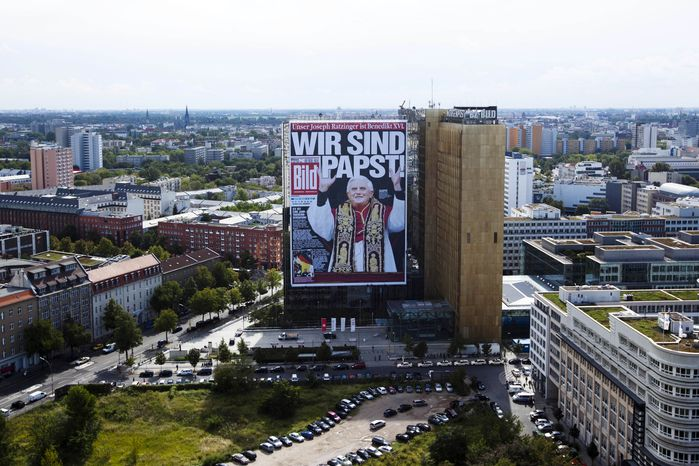 """In anticipation of Pope Benedict XVI's visit to his German homeland, the tabloid Bild Zeitung has covered its headquarters in Berlin with a giant reprint of its front page of April 20, 2005, when Benedict was elected. The headline reads, """"We Are Pope!"""" (AP Photo/Markus Schreiber)"""