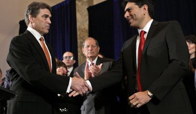 Texas Gov. Rick Perry (left), who is running for the 2012 Republican presidential nomination, greets Danny Danon (right), deputy speaker of the Israeli Knesset, as Rep. Robert Turner (center), New York Republican, applauds during a news conference in New York on Tuesday, Sept. 20, 2011. (AP Photo/Mary Altaffer)