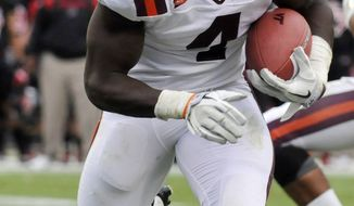 ASSOCIATED PRESS Virginia Tech's David Wilson rushed for just 85 yards against Arkansas State on Saturday, but quarterback Logan Thomas was free to pass for 292.