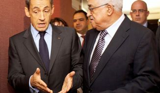 French President Nicolas Sarkozy (left) and Palestinian Authority President Mahmoud Abbas meet Tuesday at a New York hotel during the U.N. General Assembly session. Mr. Sarkozy has proposed a one-year timetable for establishing a Palestinian state. (Associated Press)