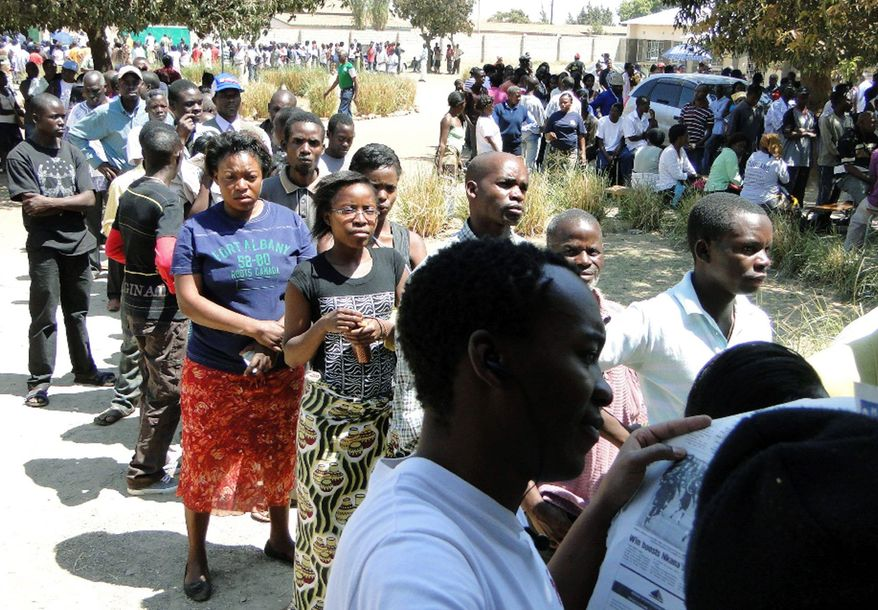 People in Lusaka, Zambia, line up to vote in the national elections Tuesday. Fresh violence broke out in Zambia on Wednesday as residents in Solwezi, a small mining town, accused election workers of trying to deliver unsealed ballot boxes. (Associated Press)