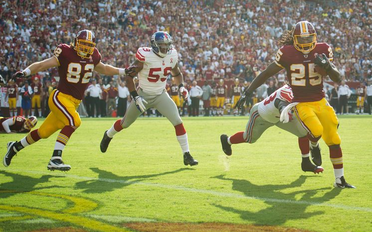 Tim Hightower of the Washington Redskins (25) runs in a touchdown against the New York Giants during the 2nd quarter at FedEx Fie
