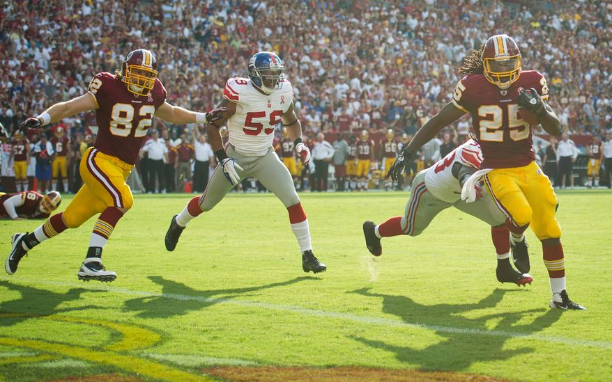 Tim Hightower of the Washington Redskins (25) runs in a touchdown against the New York Giants during the 2nd quarter at FedEx Field in Landover, Md. Sunday, September 11, 2011. (Rod Lamkey Jr. / The Washington Times)