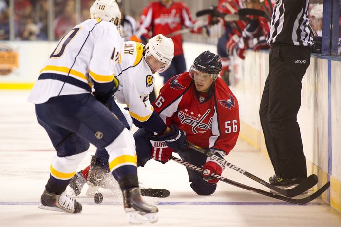 Chris Bourque (56) of the Washington Capitals fights for the puck with Craig Smith (15) of the Nashville Predators in the first period of the Washington Capitals  loss to the Nashville Predators, 2-0, in a preseason exhibition game at the 1st Mariner Arena, Baltimore, MD, Tuesday, September 20, 2011. (Andrew Harnik/The Washington Times)