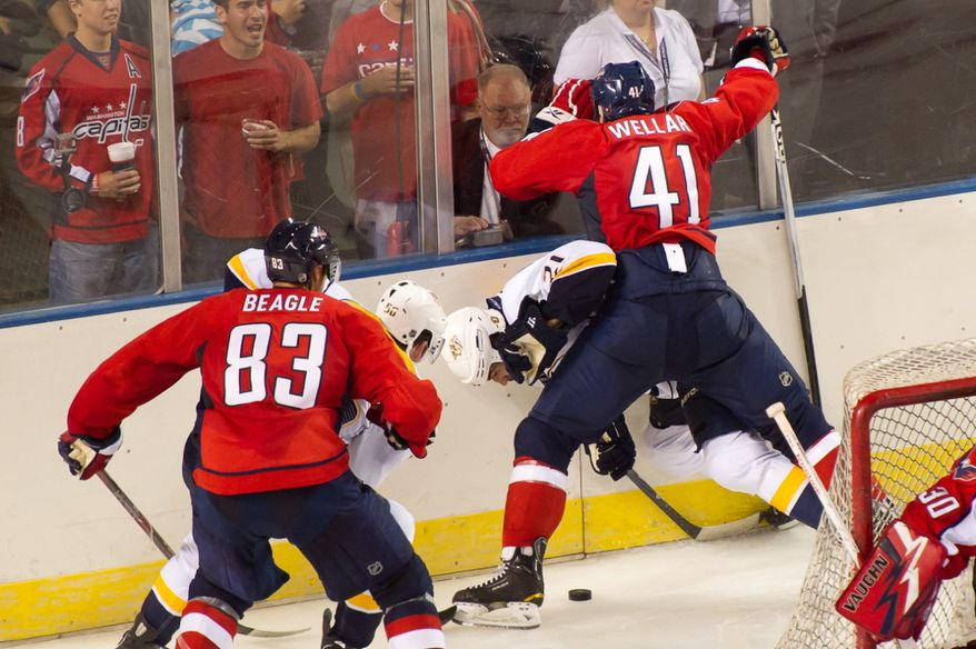 Patrick Wellar (41) of the Washington Capitals sandwiches Zack Stortini (21) of the Nashville Predators against the wall in the second period of the Washington Capitals loss to the Nashville Predators, 2-0, in a preseason exhibition game at the 1st Mariner Arena, Baltimore, MD, Tuesday, September 20, 2011. (Andrew Harnik/The Washington Times)