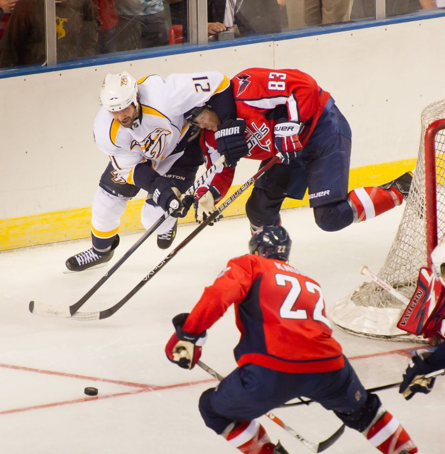 Jay Beagle (83) of the Washington Capitals and Zack Stortini (21) of the Nashville Predators fight each other for the puck in the second period of the Washington Capitals loss to the Nashville Predators, 2-0, in a preseason exhibition game at the 1st Mariner Arena, Baltimore, MD, Tuesday, September, Sept. 20, 2012. (Andrew Harnik/The Washington Times)