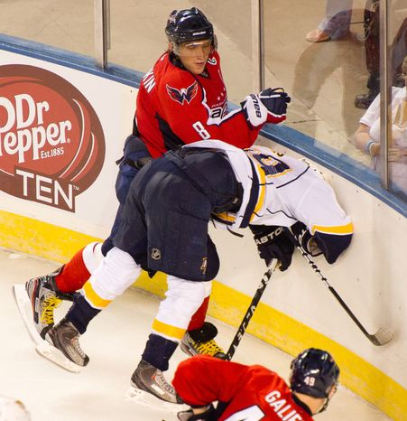 Alex Ovechkin (8) of the Washington Capitals slams Ryan Ellis (49) of the Nashville Predators into the wall in the second period of the Washington Capitals loss to the Nashville Predators, 2-0, in a preseason exhibition game at the 1st Mariner Arena, Baltimore, MD, Tuesday, September 20, 2011. (Andrew Harnik/The Washington Times)