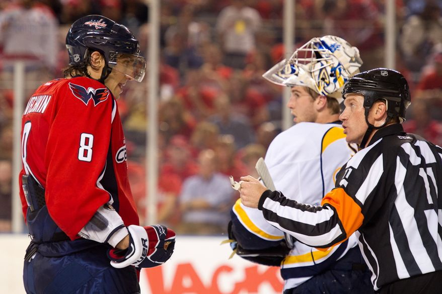 Alex Ovechkin (8) of the Washington Capitals argues a call with a referee in the final seconds of the Washington Capitals loss to the Nashville Predators, 2-0, in a preseason exhibition game at the 1st Mariner Arena, Baltimore, MD, Tuesday, September 20, 2011. (Andrew Harnik/The Washington Times)
