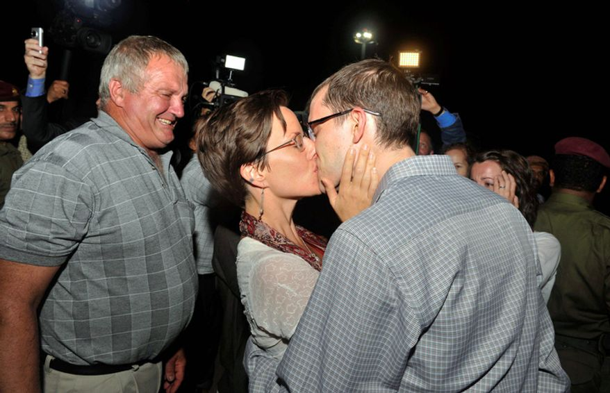Freed American Shane Bauer (right) kisses fiancee Sarah Shourd upon his arrival in Muscat, Oman, from Tehran on Wednesday, Sept. 21, 2011. (AP Photo/Sultan Al-Hasani)