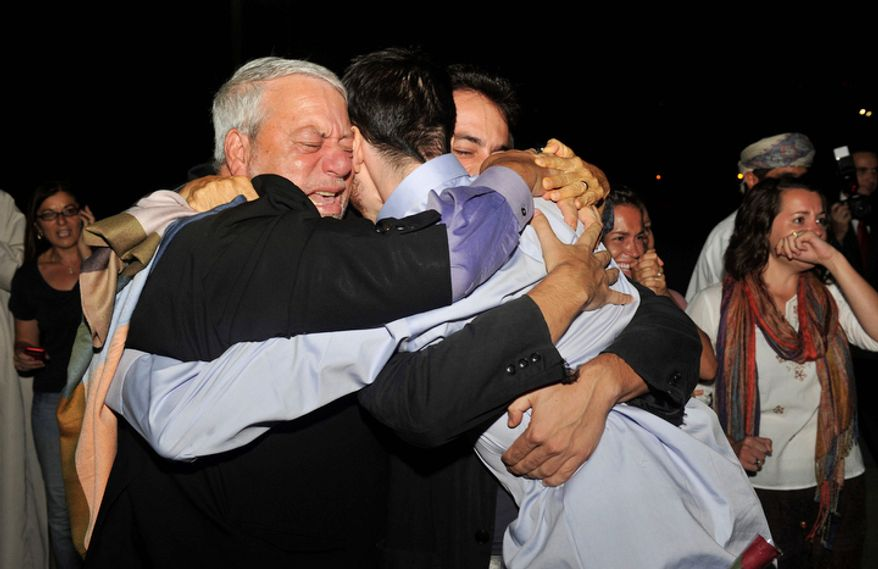 Freed American Josh Fattal (center, in blue shirt) hugs his relatives upon arriving in Muscat, Oman, from Tehran on Wednesday, Sept. 21, 2011. After more than two years in Iranian custody, Mr. Fattal and Shane Bauer took their first steps toward home Wednesday as they bounded down from a private jet and into the arms of family for a joyful reunion in the Gulf state of Oman. (AP Photo/Sultan Al-Hasani)