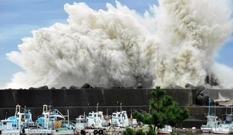 Surging waves hit against the breakwater in Udono in a port town of Kiho, Mie Prefecture, central Japan, Wednesday, Sept. 21, 2011.  (AP Photo/Chunichi Shimbun, Daiji Yanagida)