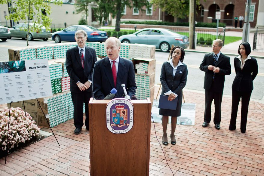 Maryland Comptroller Peter V.R. Franchot on Thursday announces indictments in several cigarette-smuggling cases. Flanking him in Upper Marlboro are Assistant State's Attorney Doyle Niemann and Prince George's County State's Attorney Angela D. Alsobrooks. (T.J. Kirkpatrick/The Washington Times)