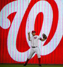 Washington Nationals pitcher Stephen Strasburg warms up near the warning track as the Nationals host the Los Angeles Dodgers at Nationals Park in Washington, DC, Tuesday, September 6, 2011. (Rod Lamkey Jr./The Washington Times)