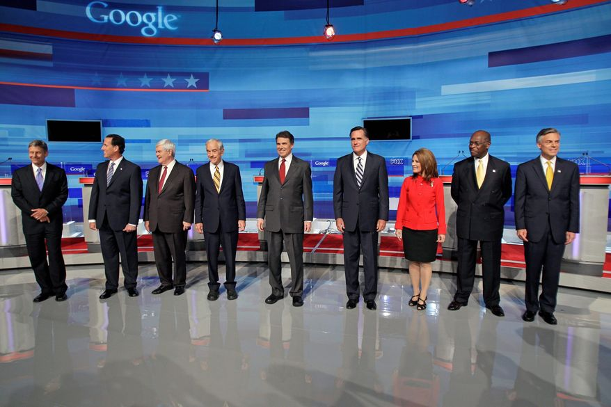 Republican presidential hopefuls acknowledge the audience Sept. 22 in Orlando, Fla., before a debate. They are (from left) former New Mexico Gov. Gary E. Johnson, former Pennsylvania Sen. Rick Santorum, former House Speaker Newt Gingrich, Rep. Ron Paul of Texas, Texas Gov. Rick Perry, former Massachusetts Gov. Mitt Romney, Rep. Michele Bachmann of Minnesota, businessman Herman Cain and former Utah Gov. Jon Huntsman Jr. (Associated Press)