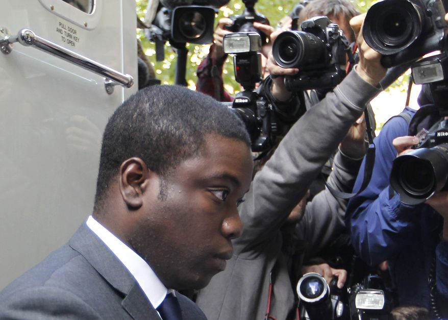 ** FILE ** Kweku Adoboli arrives for a hearing in City of London Magistrates' Court in London on Thursday, Sept. 22, 2011. He is accused of fraud and two charges of false accounting over three years at Swiss banking giant UBS. (AP Photo/Sang Tan, File)