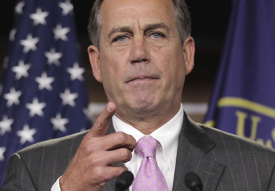 House Speaker John Boehner of Ohio tells reporters on Capitol Hill on Sept. 22, 2011, that there will not be a government shutdown despite the failure of the continuing resolution on the previous day. (Associated Press)