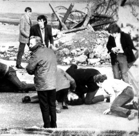 **FILE** This photo from Jan. 30, 1972, shows a man receiving attention during the shooting incident in Londonderry, Northern Ireland, which became known as Bloody Sunday. (Associated Press)