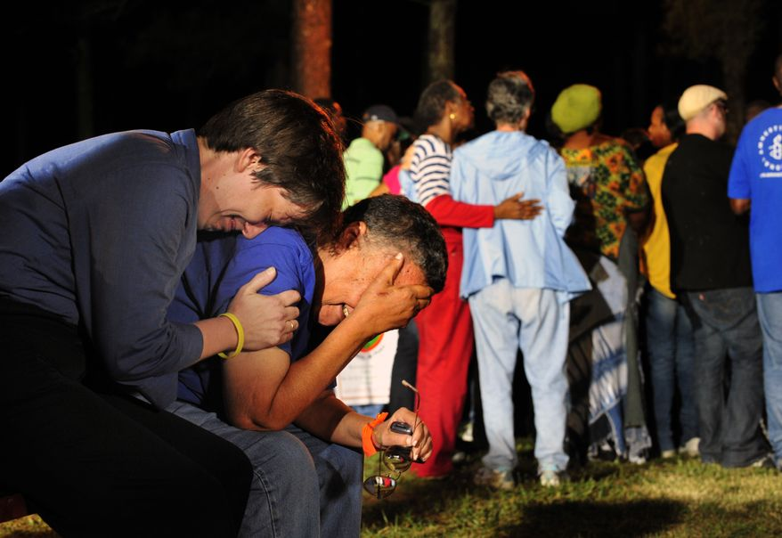Minister Lynn Hopkins (left) comforts her partner Carolyn Bond in Jackson, Ga., on Sept. 21, 2011, after hearing that the U.S. Supreme Court rejected a last-minute plea of Georgia death row inmate Troy Davis. Davis, who was convicted of killing off-duty Savannah officer Mark MacPhail in 1989, was executed later that night. (Associated Press)